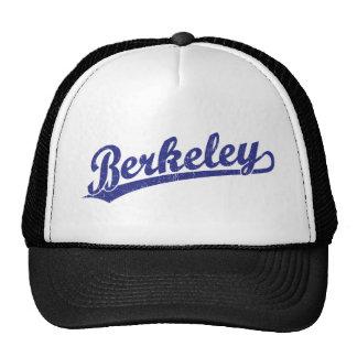 Berkeley script logo in blue trucker hat