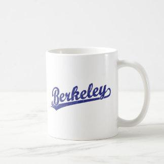Berkeley script logo in blue coffee mugs