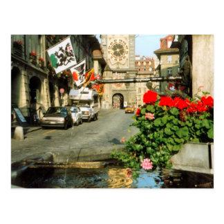 Berne, Main street,clocktower and geraniums Postcard