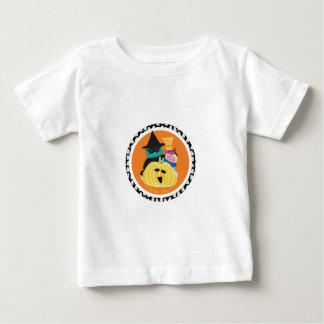 Bernie and Mina behind a Pumpkin Baby T-Shirt