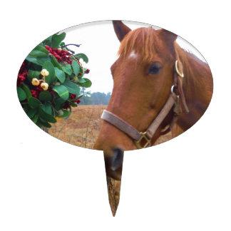 Besar el caballo debajo del muérdago figuras de tarta