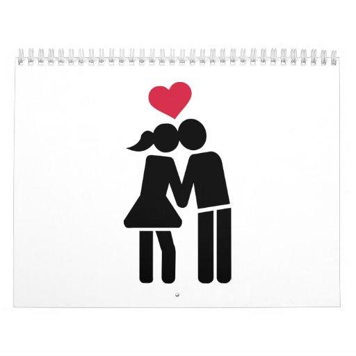 Besar el corazón del rojo de los pares calendarios