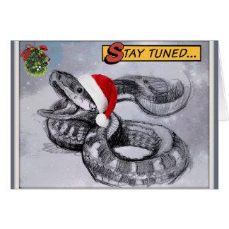 Béseme debajo de la serpiente del navidad del tarjeta de felicitación