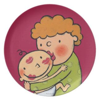 Besos rosados del lápiz labial de la abuela para platos de comidas