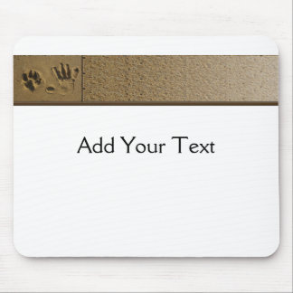 Best Friends Dog Paw and Hand Print in the Sand Mousepads