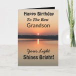 "Best Grandson Light Shines Bright Birthday Card<br><div class=""desc"">Express your wishes to your grandson for a happy day on an inspirational sunset birthday card with the verse ""Your Light Shines Bright"". The minimal design is modern with bold colors of gold and black showing glowing water and a peaceful lake.</div>"