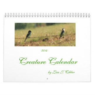 Bestias y pájaros del calendario 2014 de la criatu