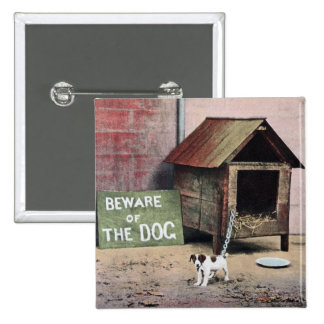 Beware of dog sign with small dog buttons