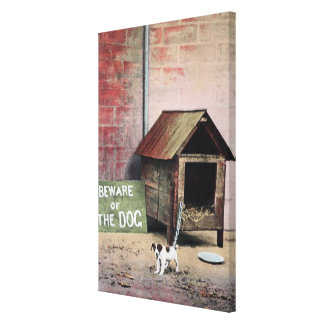 Beware of dog sign with small dog stretched canvas print