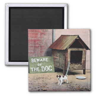 Beware of dog sign with small dog magnet