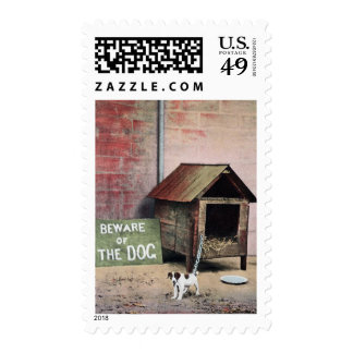 Beware of dog sign with small dog postage stamp