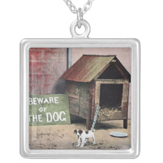 Beware of dog sign with small dog silver plated necklace