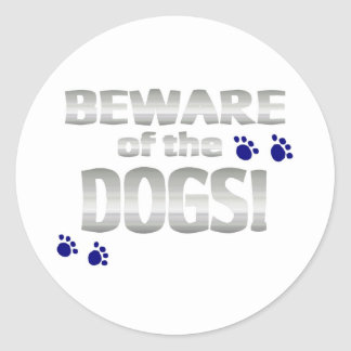 Beware of the dogs! with blue paw prints classic round sticker
