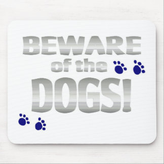 Beware of the dogs! with blue paw prints mouse pad