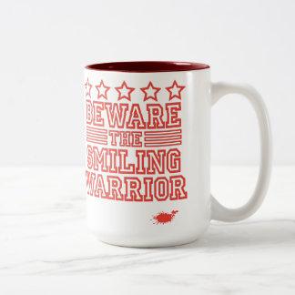 Beware the Smiling Warrior Coffee Mugs
