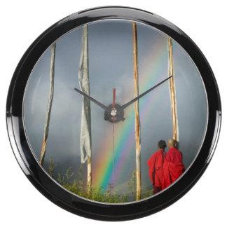 Bhutan, Gangtey village, Rainbow over two monks Aqua Clocks