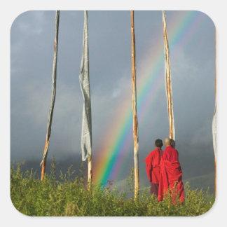 Bhutan, Gangtey village, Rainbow over two monks Square Stickers
