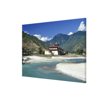 Bhutan, Punaka. The Mo Chhu River flows past Canvas Print