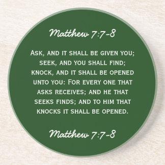 Bible passage Matthew 7:7-8 in white text. Drink Coaster