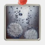 Bicarbonate of soda tablets in water ornament