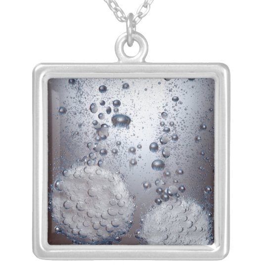 Bicarbonate of soda tablets in water silver plated necklace