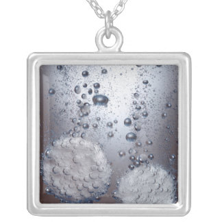 Bicarbonate of soda tablets in water square pendant necklace