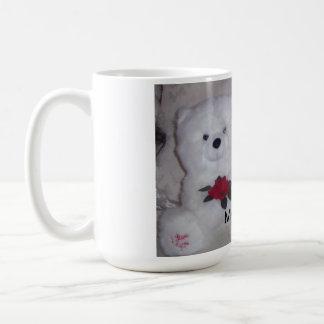 Bichon frise with white teddy bear. coffee mug