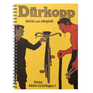 Bici amarilla del poster de la publicidad de la bi libro de apuntes con espiral
