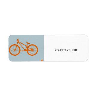 Bici anaranjada etiqueta de remite