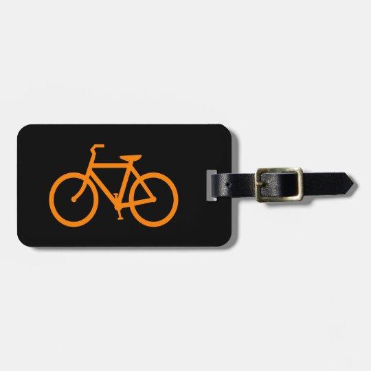 Bici anaranjada etiquetas para maletas