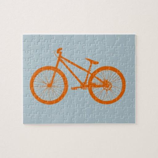 Bici anaranjada rompecabezas con fotos