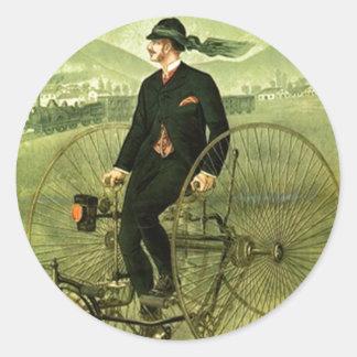 Bici antigua de la publicidad del triciclo de la pegatina redonda