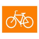 Bici blanca y anaranjada