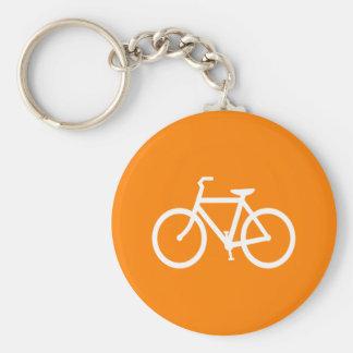 Bici blanca y anaranjada llavero redondo tipo pin