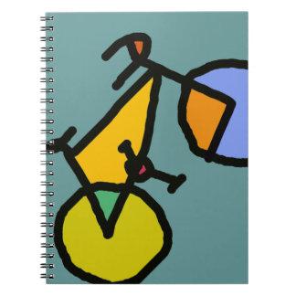 bici del color libro de apuntes con espiral