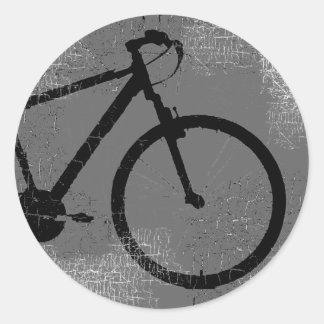 bici negra en un círculo pegatina redonda