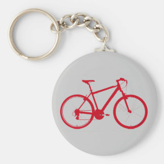 bici roja, completando un ciclo llavero redondo tipo pin