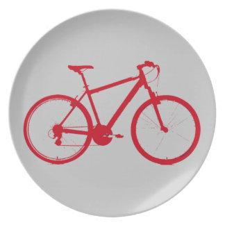 bici roja, completando un ciclo platos para fiestas