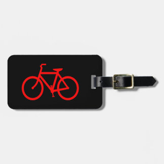 Bici roja etiquetas maleta