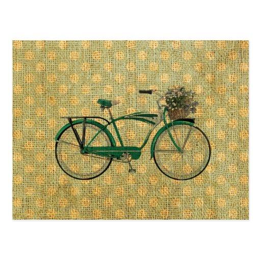 Bici verde retra con la cesta de la flor tarjeta postal