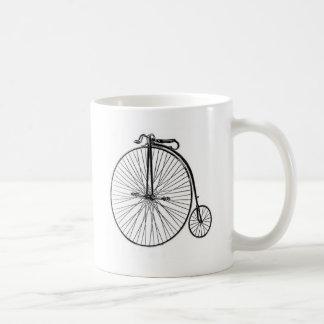 Bicicleta antigua del comino del penique tazas de café