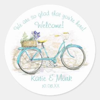 Bicicleta con la recepción de la aguamarina de la pegatina redonda
