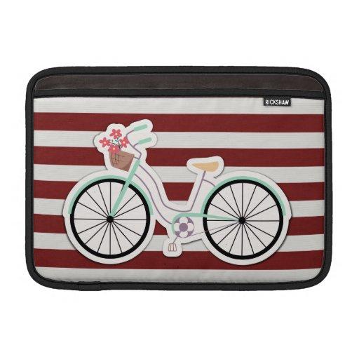Bicicleta con las flores en un fondo rojo y blanco funda  MacBook