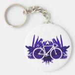Bicicleta de la pista en violeta llaveros