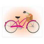 Bicicleta de las rosas fuertes con los naranjas tarjeta postal