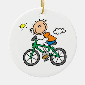 Bicicleta del montar a caballo - varón adorno navideño redondo de cerámica
