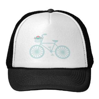 Bicicleta del trullo del vintage con las flores gorro
