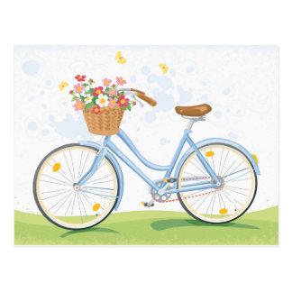 Bicicleta del vintage con la cesta de la flor postales
