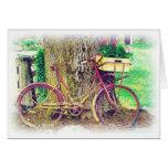 Bicicleta del vintage con la cesta de la flor felicitación