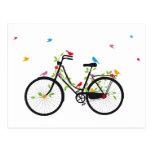 Bicicleta del vintage con las flores y los pájaros postal